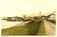 Circa 1930. The main road showing the wooden pier and the Kings Arms Hotel.
