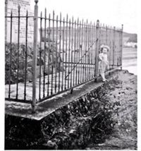 Circa 1950. Railings around the war memorial, the little girl is Ruth Soper.