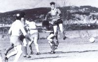 Circa 1988 –Football Action at Kyleakin Michael Taylor (airborne) with left hand on Peter Robertson