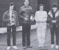 "Trophy winners from the recent New Year ""fun runs"" from Broadford and Ashaig to Kyleakin - 4th Jan 1986. Left to Right: Calum Jack (Dornie), winner of the junior event; senior winner Gordon Jeffrey (Ardvasar); Catherine Grant (Kyleakin), the only adult lady to brave the elements; and Caroline MacPherson (Kyleakin), first junior girl home."